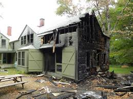 green home design architect remodeling a house with fire damage
