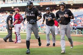 marlins continue streak beat phillies 12 8 in game 1 fish