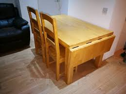 solid wood extending dining table and chairs in bearsden