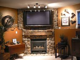 black fireplace on the brown nature stone wall combined with shelf