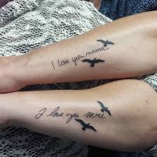couple matching tattoos between mothers and daughters on inspirationde
