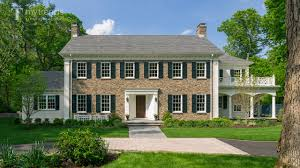 Colonial Homes For Sale by Traditional New England Colonial House With Woodlands Backdrop
