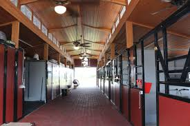 raised center aisle rca barns md building systems of florida raised center aisle rca barns interior of rca barn with horse stalls