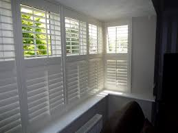 box bay window shutters front and sides lower louvres closed