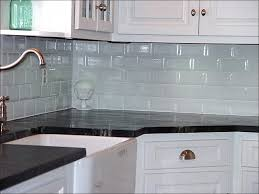 honed calacatta gold marble countertops with white subway tiles in