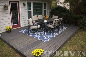 How To Stain Concrete Patio Yourself Diy Concrete Patio Cover Ups Diy Concrete Patio Stained Decks