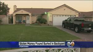 fbi finds 600 000 from armored car heist buried in backyard la