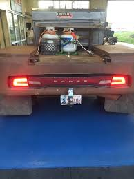 custom truck tail lights dodge charger taillights mounted on oil field work trucks are a
