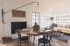 dining table in front of fireplace country club summer thornton design