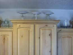 What To Put Above Kitchen Cabinets by Decorating The Top Of The Kitchen Cabinets Organize And Decorate