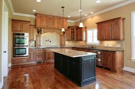 maple cabinets with black island luxury kitchen plan with rustic black island using elegant