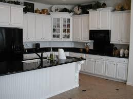 White Kitchen Cabinets Grey Walls Some Patching Lamps Subway Tile - Brown subway tile backsplash