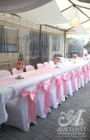 pink chair sashes white chair covers and pink lace sashes and hessian table runners