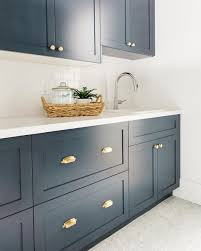 beautiful traditional white kitchen blue white brass and bm hale navy pure white caesarstone countertops brass hardware studiomcgee