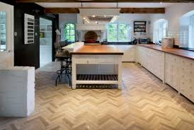 Exclusive Kitchen Design by Kitchen Herringbone Floor Tumbled Marble Black Chalk Wall