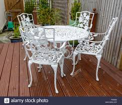 cast iron outdoor table white cast iron garden table and chairs in a back garden stock photo