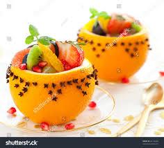 fruit salad hollowedout oranges studded cloves stock photo