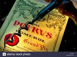 learn about petrus pomerol bordeaux traditional corkscrew and bottle label of 1953 chateau petrus