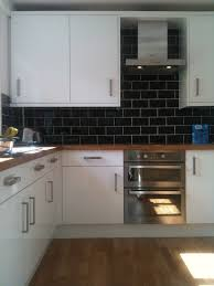 gloss kitchen tile ideas black splash white cabinets and wooden bench top house and home