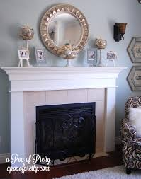 mantel fireplace mantel decor with round mirror and photo frames
