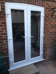french doors with cill horns and scribed arch head in hove