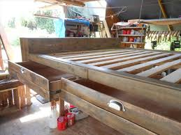 Making A Platform Bed From Pallets by Diy Pallet Bed With Storage Drawers 101 Pallets