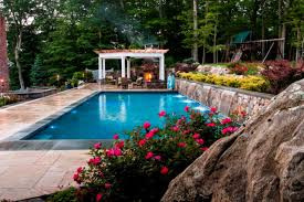 a new york poolscape accessorized with stone and rock hgtv
