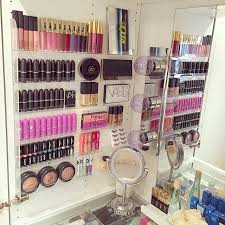 gorgeous makeup display using a nail polish rack vanity ideas