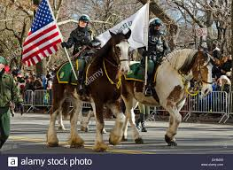 thanksgiving day parade nyc members of the mounted parks enforcement patrol ride in the macy u0027s