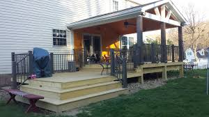 exterior rustic open concept wood deck with metal railings and