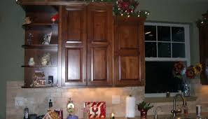 decorating kitchen cabinet tops for christmas decor cabinets