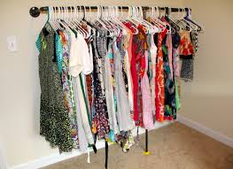 27 hundred dresses making a wall mounted garment rack life