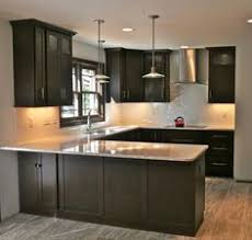 Modern Gray Kitchen Features Dark Gray Flat Front Cabinets Paired - Kitchen modern backsplash