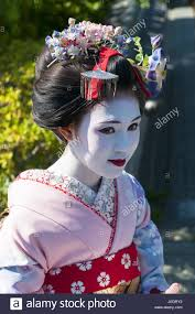 young beautiful japanese women called maiko wear a traditional