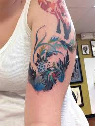 phoenix tattoo mixture of water colour and traditional tattoo