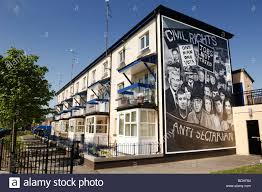 murals on houses in free derry in remembrance of bloody sunday