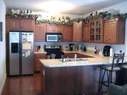 decorating ideas above kitchen cabinets ideas for space above kitchen cabinets truequedigital info