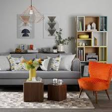 orange livingroom the application of orange and cool grey in this living room set