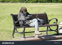 homeless man sleeping on park bench stock photo 2334763 shutterstock