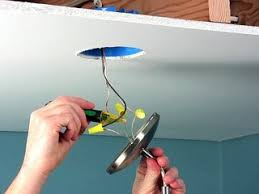 how to hang a heavy light fixture from the ceiling how to install a ceiling fan mounting bracket the family handyman