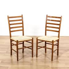 this pair of danish modern chairs are featured in a solid wood