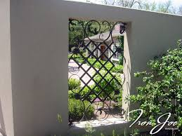 ornamental iron fence accent to stucco property fence exterior