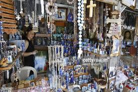 christian gift shop lebanese vendor sells christian relics at a gift shop outside the