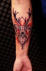 unique watercolor deer head tattoo design on forearm