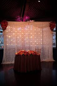 wedding backdrop reception twinkling candles reception backdrop draped white fabric with