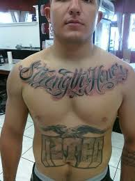 strength honor lettering tattoo on chest real photo pictures