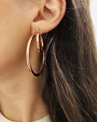 earring top of ear calling it these will be the top earring trends of 2018 who