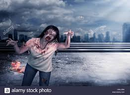 halloween zombie background scary female zombie with burning city background halloween