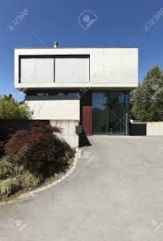 modern house entrance entrance of a modern house in beton stock photo picture and