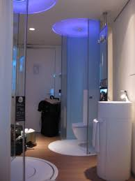 shower with white furniture and fluorescent ceiling lighting